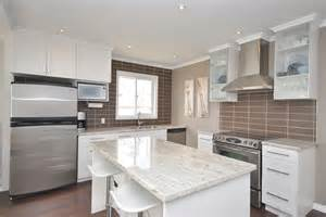 White Kitchen Cabinets With White Granite Countertops Kitchen White Shaker Cabinets River White Granite Counter Chocolate Backsplash Maytag Fridge