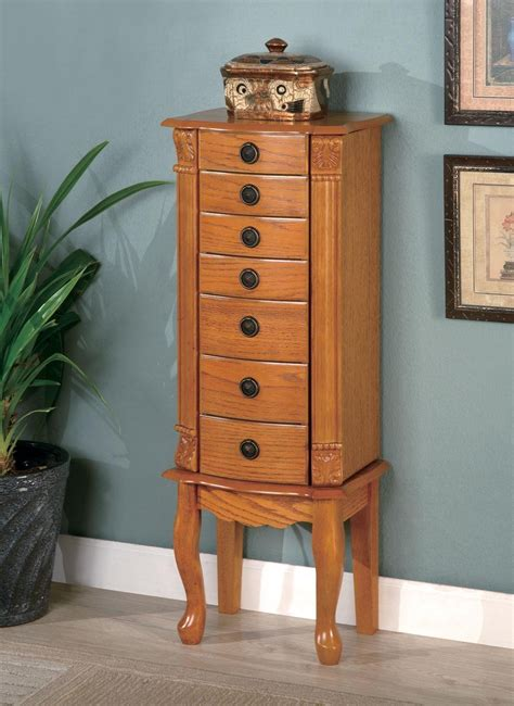 jewelry armoire oak oak warm brown oak jewelry armoire 900135 from coaster