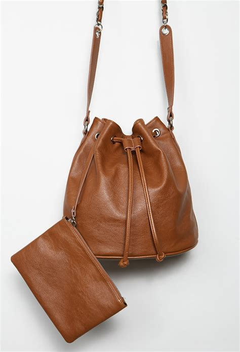 brown faux leather lyst forever 21 faux leather drawstring bucket bag in brown