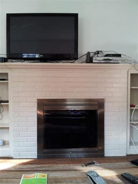 Mounting TV above fireplace. Plaster with metal behind