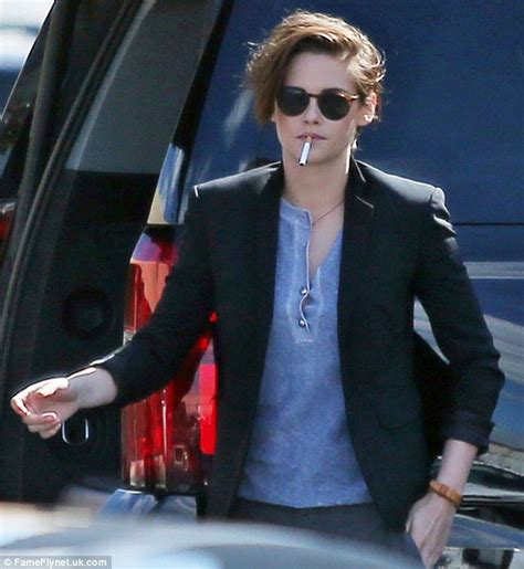 kristen stewart puffs on a cigarette as she shows off a