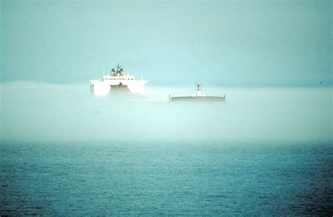 canoes in a fog lake superior great lakes national program office image collection