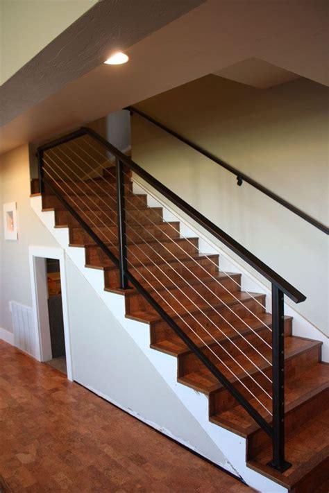 cork stairs  metal rail basement stairs stair