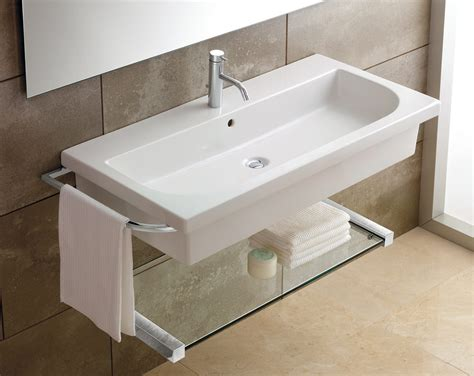 under bathroom sink shelf bahtroom big window near simple mirror on calm wall tile