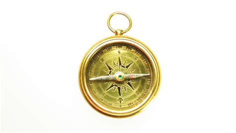 swinging the compass old brass compass compass with needle swinging isolated on