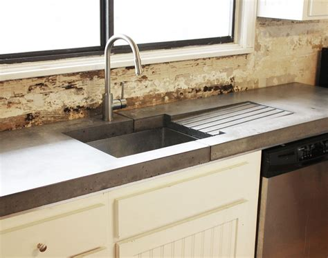 concrete counter with stainless sink built in drain board