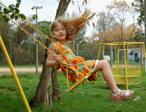 girl in swing file little girl on swing jpg wikipedia
