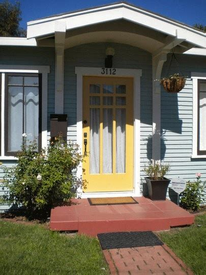 blue house yellow door light blue house with yellow door outside pinterest