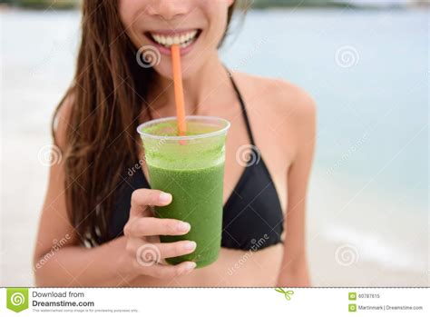 Supermodel Detox Smoothie by Green Smoothie Holding Detox Juice In Sun Stock
