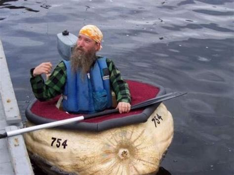 giants boat picture man rowing a boat made from a giant vegetable pics