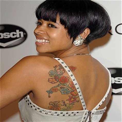 best rapper tattoos kelis left side back tattoo2 png