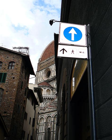 public bathrooms in italy burnt to a crisp signage in italy tuscan traveler
