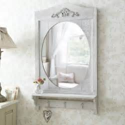 Mirror with white floating bathroom shelving in guest small bathroom