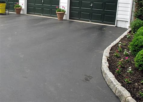 driveway edging 9 steps to driveway edging with cobblestone pavers