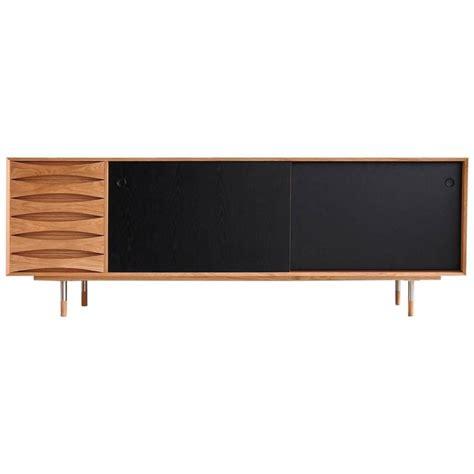 Oak Sideboard Modern scandinavian modern style oak sideboard with reversible black sliding doors for sale at 1stdibs