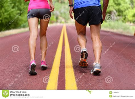 running people runners jogging shoes and legs stock
