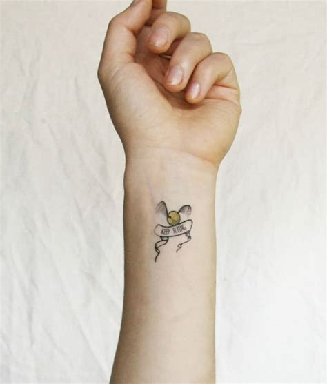 golden snitch tattoo temporary tattoos for harry potter fans fubiz media