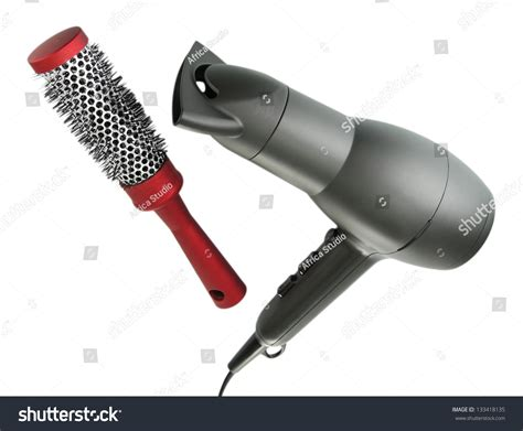 Hair Dryer And Comb hair dryer and comb brush isolated on white stock photo