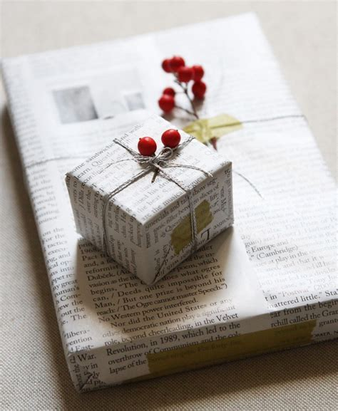 gift wrapping with newspaper ideas diy gift wrapping with newspaper and berries remodelista