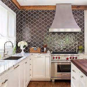 moroccan tile kitchen backsplash brown granite countertops transitional kitchen