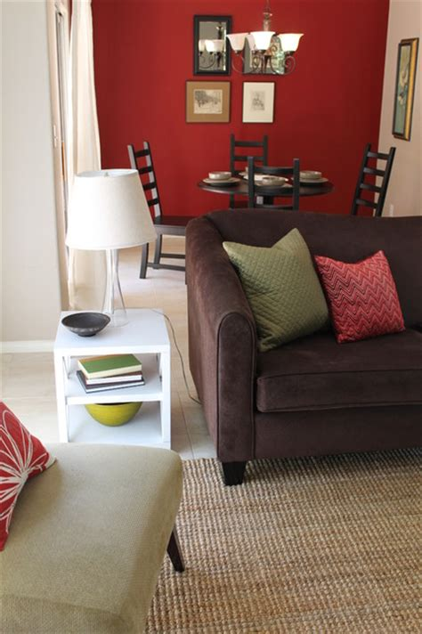 green and red living room transitional style with sage green accents and red walls