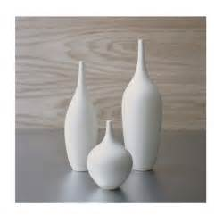 trio of white ceramic bottle vases in modern matte white