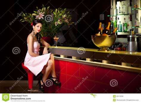 Woman Sitting At The Bar Stock Photo   Image: 20172230