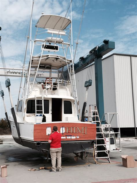 boat names with red sportfish transom vinyl wood wrap to look like wood