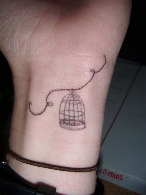 small bird tattoo meaning bird cage tattoos designs ideas and meaning tattoos for you