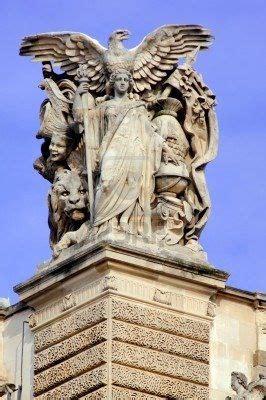 france paris ancient famous monuments louvre palace architectural detail stone statue