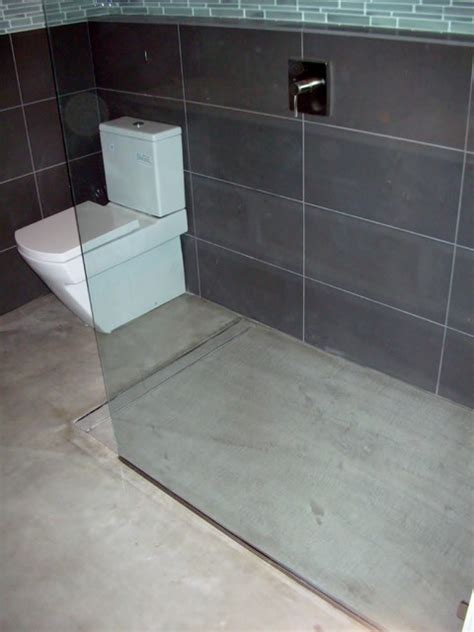 How To Build A Shower Floor On Concrete by Modern Open Concept Bathroom Featuring A Concrete Floor