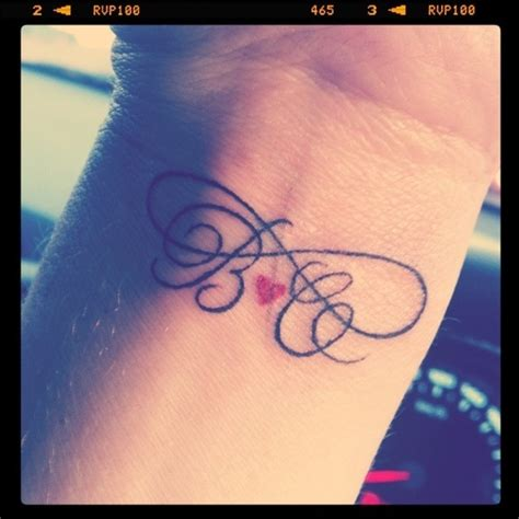 tattoo infinity letters letters and small heart infinity tattoo tattoomagz
