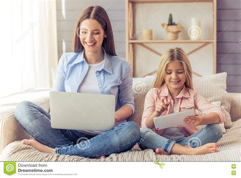 mom on sofa mom and daughter at home stock photo image 72558884