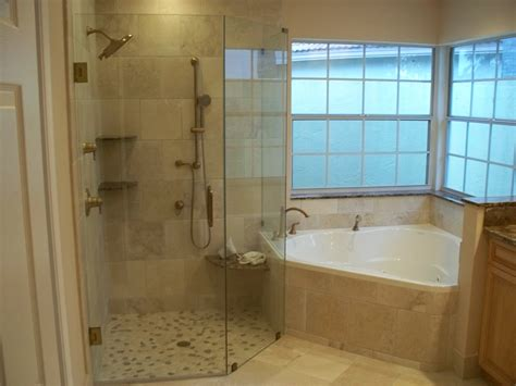 small corner white bathtub and brown ceramic tiled wall