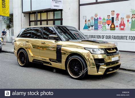 black and gold range rover saudi gold range rover parked outside of selfridges