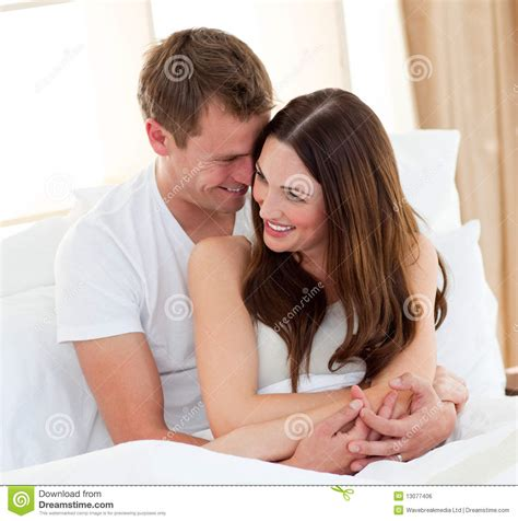 lovers in bed romantic lovers embracing lying in bed royalty free stock image image 13077406