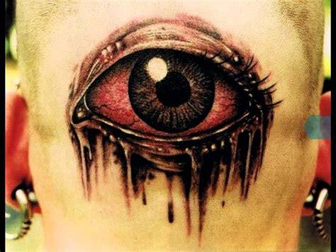 red eye tattoo and black scary eye design