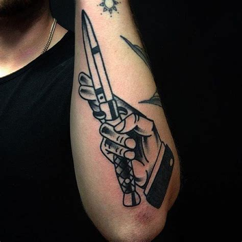 dagger tattoo on finger meaning traditional hand dagger tattoo by justin wayne tattoos