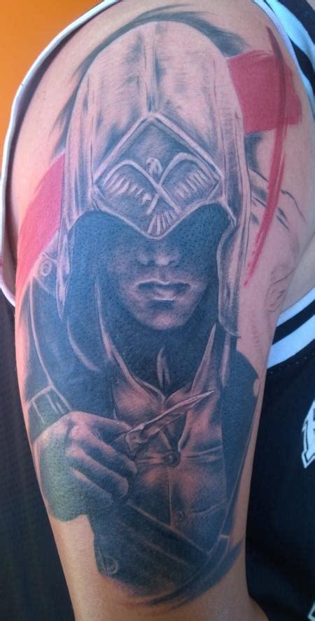 assassins creed tattoo sleeve assassin s creed trash polka tattoo by chloe deboo