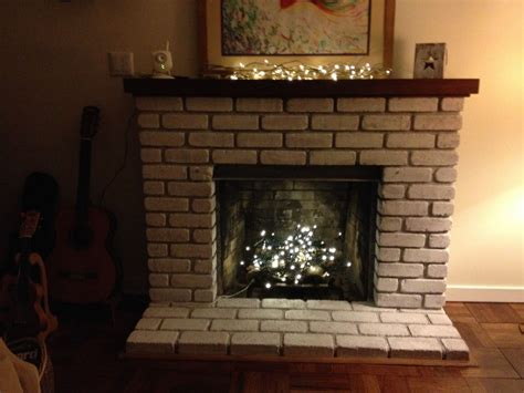 easy fireplace makeover hometalk easy fireplace makeover whitewash the brick