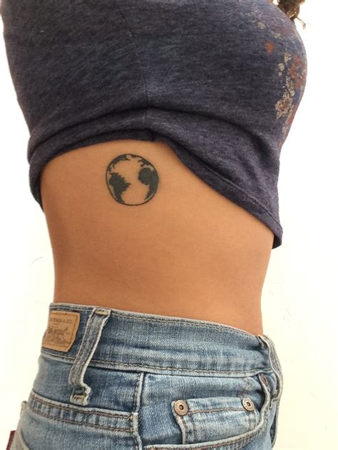 earth tattoo on side of a planet earth tattoos