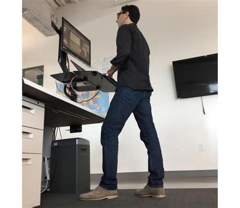 calories burned standing desk here s how many more calories you burn daily with a