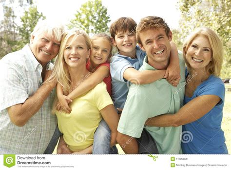 A Friend Of The Family by 3 Generation Family In Park Royalty Free Stock Photos