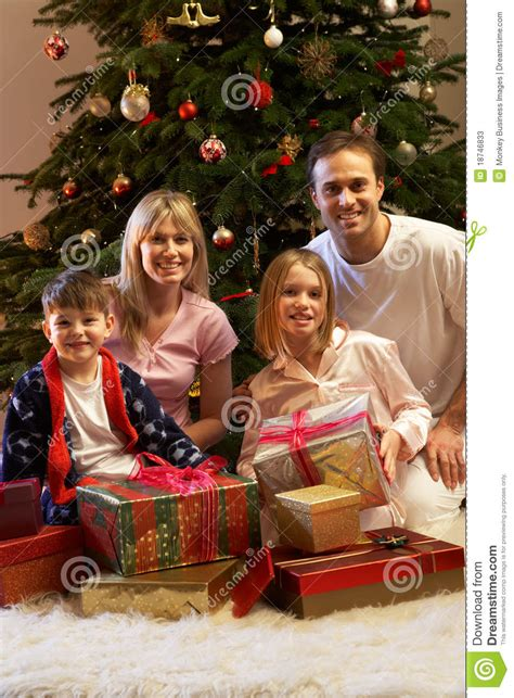Family Opening Christmas Presents Stock Photos - Image ... Happy Kids Opening Christmas Presents