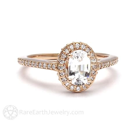 white sapphire engagement ring with oval halo