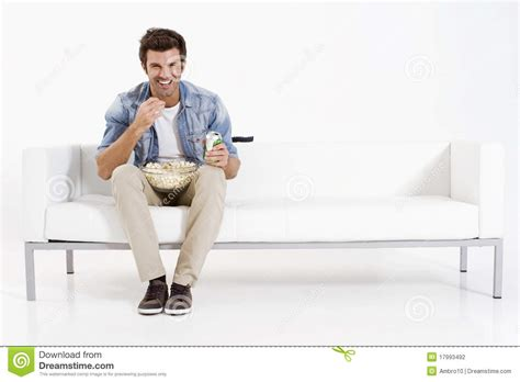 a man and a couch single man on the couch watching tv stock photo image