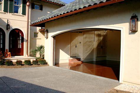 Inside Garage Designs outdoor floor coating epoxy in front of garage house and