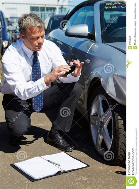 Auto Damage Adjuster by Loss Adjuster Inspecting Car Involved In Stock Photo Image 31863550