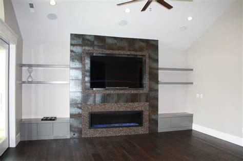 Perry Homes Design Center Utah entertainment center linear fireplace tiled wall kuehn