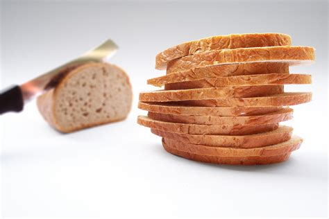 carbohydrates 1 slice bread stack of wheat sliced bread on top of white surface 183 free